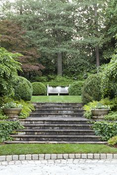Formal garden axis with Cotswold stone bench by Howard Design Studio.