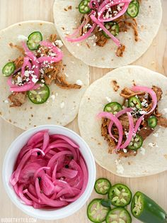 Pickled Red Onions are a great way to use leftover red onion and are a great topping for tacos, sandwiches, pizza, and more. BudgetBytes.com