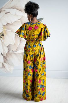 Be fun & flirty in the lovely Daia Afia Jumpsuit. This gorgeous outfit has piping in the neck and sleeve, a center back zipper, and lined bust. Find African print fashion at Kuwala. African American Fashion, African Fashion Skirts, African Fashion Designers, African Inspired Fashion, African Print Fashion, Africa Fashion, Ankara Fashion, African Print Jumpsuit, African Print Dresses