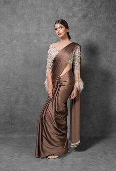 Brown and White Silk Saree features Pure Silk Satin Saree and a Tulle Blouse. Embroidery work is hand-crafted using thread, stone embellishments and sequence. For customers that require Modest Tailoring, please state it in the tailoring form in th Trendy Sarees, Stylish Sarees, Fancy Sarees, Blouse Back Neck Designs, Saree Blouse Designs, Simple Saree Designs, New Saree Designs, Simple Sarees, Dress Indian Style