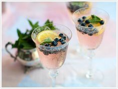 Blueberry-Lemon Fizz  •1/2 cup fresh blueberries   •1 lemon, thinly sliced and seeds removed   •4 mint sprigs   •Italian soda Pink Grapefruit – or whatever fruity flavor you like!