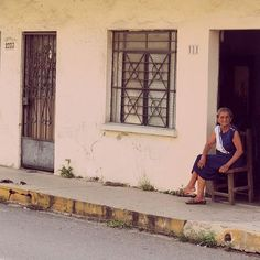 Woman watching the world passing by in Old Town Mazatlan, Mexico