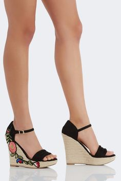 Chic pair of wedges with soft suede finish. Adjustable ankle strap for fit and bold floral patch detailing on one side.