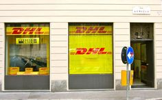 insegne negozi, insegne luminose negozi, insegne negozi DHL Servicepoint