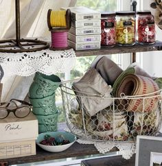 Button jars, rolled ribbon, stacked cups...