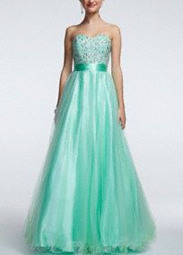 Fairytale dreams do come true and can happen for you on prom night in this exquisite tulle ball gown!  Strapless bodice with sweetheart neckline features dazzling beaded bust.  Sash at waist helps define the silhouette.  Full length tulle skirt is fun and sweet.  Fully lined. Back zip. Imported polyester. Dry clean.   Available in Plus sizes as Style 50557W.