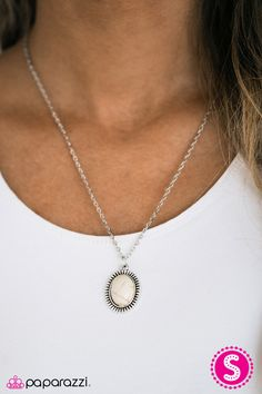 CAST IN SANDSTONE - WHITE ($5) A refreshing white stone is pressed into the center of a textured silver frame, creating a perfect pop of color below the collar. Features an adjustable clasp closure. Includes a pair of free matching earrings.
