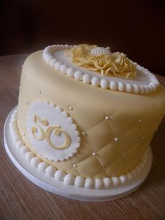 50th anniversary cake with ruffle flower