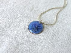 This blue enamel pendant is small and dainty. It's made in aqua blue color with a splash of dark navy blue and a little hint of green.  This is a minimalist gentle necklace... #handmade #jewelry #necklace
