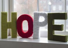 Hope I think I just found your next project. Get these cardboard letters at Hobby Lobby, Lord knows I have enough scrap yarn.  @Hope Alexander