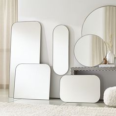 Sale ends soon. Edged with a slim gunmetal band, this minimalist wall mirror curves a subtle arch of modern elegance. A Crate & Barrel exclusive, its reflective beveled glass creates delicate interest.