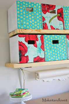 DIY Cardboard storage boxes with fabric on the front. I have plenty of boxes from moving to create these for my craft room! Cardboard Storage, Diy Storage Boxes, Diy Cardboard, Craft Storage, Storage Cubes, Storage Containers, Craft Shelves, Cardboard Letters, Cardboard Playhouse