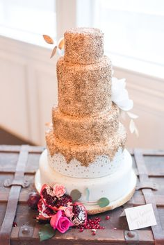 Gorgeous 5 Tier Wedding Cake with Glittery gold details.