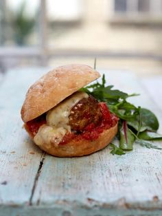 Gennaro's Meatball Sandwiches - Gennaro's homemade meatballs, cooked in a roasted red pepper tomato sauce and stuffed in a soft roll – ultimate comfort food!