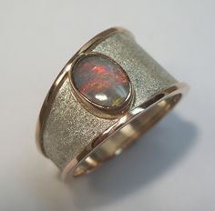 Jen Van Schmus: 14K rose gold and sterling silver bypass ring with Australian Opal.