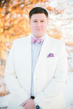 Southern groomsmen style in white dress jacket & bowtie | Chic Minnesota Winter Romance Engagement Session Featuring A Hot Chocolate Station | Photograph by Nicole Spangler Photography  http://storyboardwedding.com/chic-minnesota-winter-romance-engagement-session/