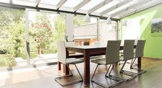 modern patio rooms with sunroom and large wood dining table also green wall paint plus laminating flooring