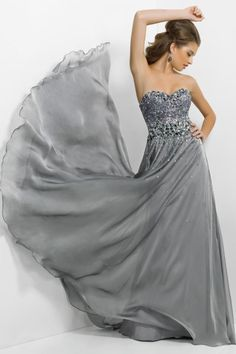 """Start out searching for your perfect long maxi strapless silver prom dress by flipping through magazines and online to see what kind of dress you are most attracted to. Then hit the stores with an idea in mind of what you are looking for. Try on as many dresses as you can; your idea of the """"perfect dress"""" may not be as well suited for you as another style. Don't limit yourself."""