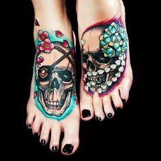 Coloured skull tattoo on feet
