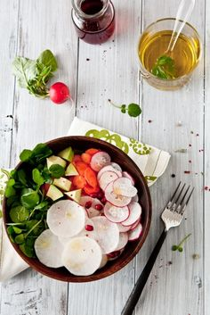 A clean organic lunch = a simple fresh salad.  This makes me feel lighter just looking at it!