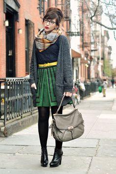 red lips, green striped skirt, yellow belt, grey sweater