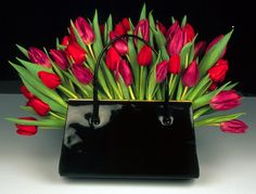 Tulips and a handbag - pretty much the most perfect bouquet I've ever seen :)  Rebel Rebel flower shop Broadway Market London