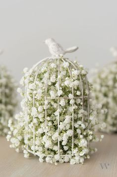 A vintage birdcage overflows with with baby's breath creating a charming décor element.