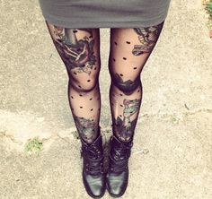 Leg tats sometimes look weird with tights, but everything is great about this picture.