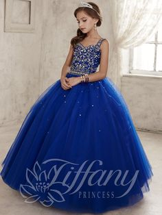 Your girl will be the cutest in this sweetheart neckline pageant style 13443 from Tiffany Princess. Thick shoulder straps are embellished with sequins and rhinestones that extend to light up the fitted bodice. Scattered details inject a lavish effect to the full tulle skirt. A lace up back is classy and functional. For extra volume wear a slip, available right here! Features:  Silhouette: A-Line Ball Gown  Neckline: Sweetheart  Fabric: Beaded/Tulle Sizes Available: 0 through 16   Colors…