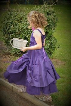 Bridesmaid with tea cup full of playing cards. Beautiful colour dress, when next to bride has the colour theme of Cheshire Cat