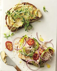 Hummus, red onion, pea shoots, bell peppers, tomato sandwich
