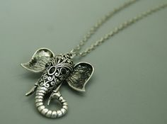 Lucky Antique Tibbet Silver  Elephant by MagicFabricHouse on Etsy, $5.39
