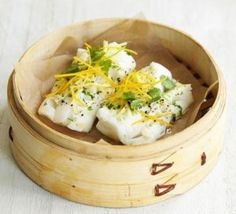 It only takes 5 ingredients to make this healthy steamed fish recipe. Delicate sea bass fillets are steamed with ginger, garlic and orange then finished with coriander. Serve with a big bowl of wilted greens for a low-fat dinner. Fish Dishes, Seafood Dishes, Seafood Recipes, Cooking Recipes, Bamboo Steamer Recipes, Steam Recipes, Free Recipes, Fodmap Recipes, Candida Recipes
