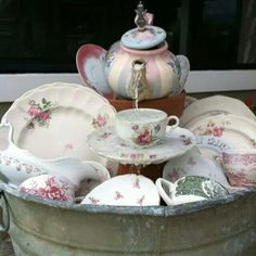 Dish pan table top water fountain..cup & saucer and the Teapot are setting atop flower pots which also hide tubing & pump.