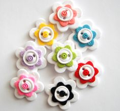 Button Pick a Pair of Flowers handmade polymer clay buttons ( 2 ). $5,00, via Etsy.