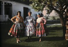 Portrait of three peasant women in traditional clothing on a farm, Hungary, late-1920s
