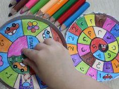 Для игры нам понадобится: пустая картонная коробочка из-под сыра; фишки-пуговицы; клей; игровой кубик; цветные карандаши, фломастеры или маркеры; белая бумага; ножницы. Приступаем к работе Начертим игровое поле. Для этого нарисуем на листе бумаги круг по диаметру коробки. Внутри круга нарисуем спираль и разделим ее на небольшие сектора. Каждый сектор игрового поля раскрасим яркими карандашами и нанесем условные метки, обозначающие условия. Например, метка «+1» будет означать, что попавший на…
