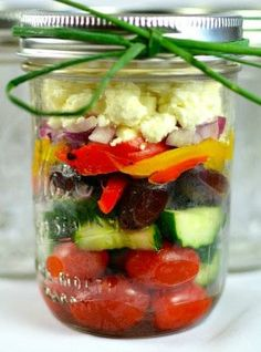 Recipe for Chunky Mediterranean Mason Jar Salad - Liven up that same old salad by layering those fresh ingredients into a Mason jar! Perfect for a party or grab and go for lunch, these layered salad jars are jammed packed with flavor. Grab, go and enjoy!