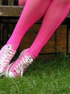 Hot pink fishnet tights and pink converse.  Awesome:-)