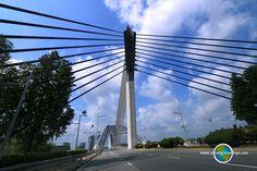 Seri Saujana Bridge is an elegant, futuristic bridge in Putrajaya. Putrajaya, Cn Tower, Wind Turbine, Futuristic, Travel Tips, Bridge, Asia, Building, Travel Advice