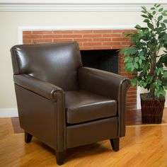 Supple and elegant, this Leeds club chair is upholstered in soft bonded leather. This overstuffed arm chair features an espresso finish on the legs.