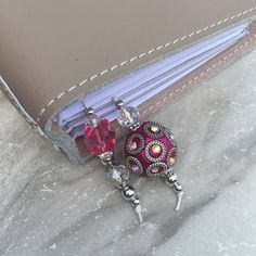 Beautiful handmade beaded bookmark PINK with silver and crystal accents to embellish your favorite travelers notebook, planner or journal. Also a great way to save your place in your favorite novel or even your bible. Drop length is approximately 2 inches.  Available sizes: Foxy Fix #2