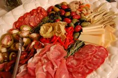 For hors d'oeuvres, guests will enjoy plates of Italian charcuterie & cheeses