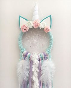 Calling all Unicorns lovers!!!! Unicorns are the thing right now and the beautiful Olivia Unicorn Dream Catcher would be the perfect addition to any little girls space! These catchers are hand crafted with love and good intentions. Materials include a fuzzy teal wrapped hoop, teal