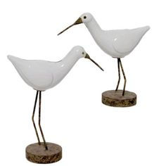 Set of 2 ceramic shorebird statuettes with weathered wood bases.    Product: Small and large bird statuetteConstruc...