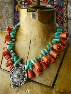 Stunning necklace by Helena Nelson-Reed. A contemporary Tibetan gau pendant is combined with Sleeping Beauty Mine (US) turquoise, bamboo coral dangles and sterling silver spacers. On either side of the clasp are conch shell beads from Nepal. Tribal Jewelry, Turquoise Jewelry, Boho Jewelry, Beaded Jewelry, Jewelry Necklaces, Handmade Jewelry, Beaded Necklace, Jewelry Design, Fashion Jewelry
