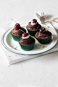 chocolate cherry cupcakes  by Hannah Blackmore Photography