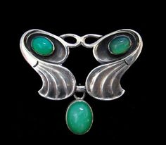 This is not contemporary - image from a gallery of vintage and/or antique objects. A. ODENWALD  A Jugendstil silver brooch, stylistically similar to the designs of Patriz Huber,  set with chalcedony and with a chalcedony drop.