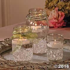 Mason Jar Centerpiece Idea; use different colored stones, candles, and ribbons for additional ideas.