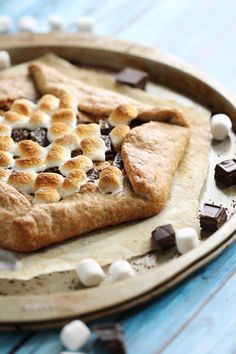 gooey s'more galette; with it's flakey, chewy graham cracker crumb infused pie crust, a layer of peanut butter, more graham crackers, melted chocolate and mini mallows